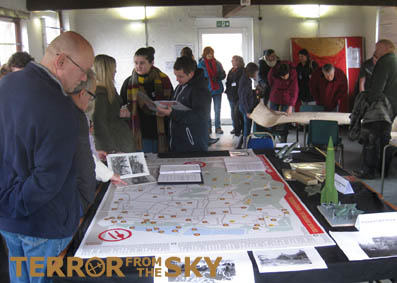Visitors look at information around the new Enfield bomb map